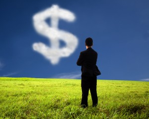 cutcaster 800900729 Businessman thinking and watching the money mark of cloud medium. 300x239 U.S. Businesses to Increase Investments in Cloud Computing   Survey